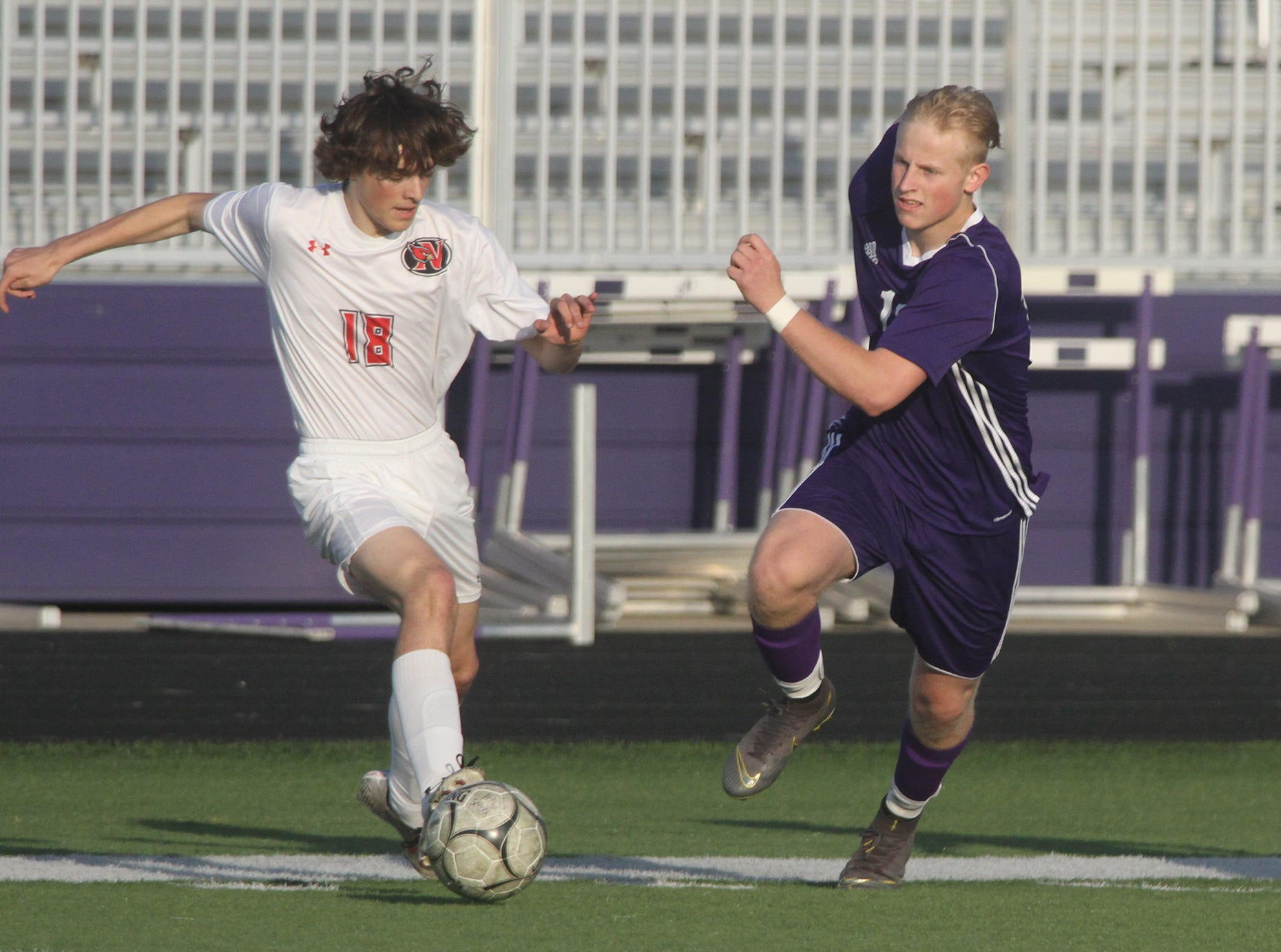 Newton sophomore Jack Suttek tries to get to the ball before being cut off by Indianola junior Peyton Boozell. Indianola beat Newton 2-0 at home in a Little Hawkeye Conference game.