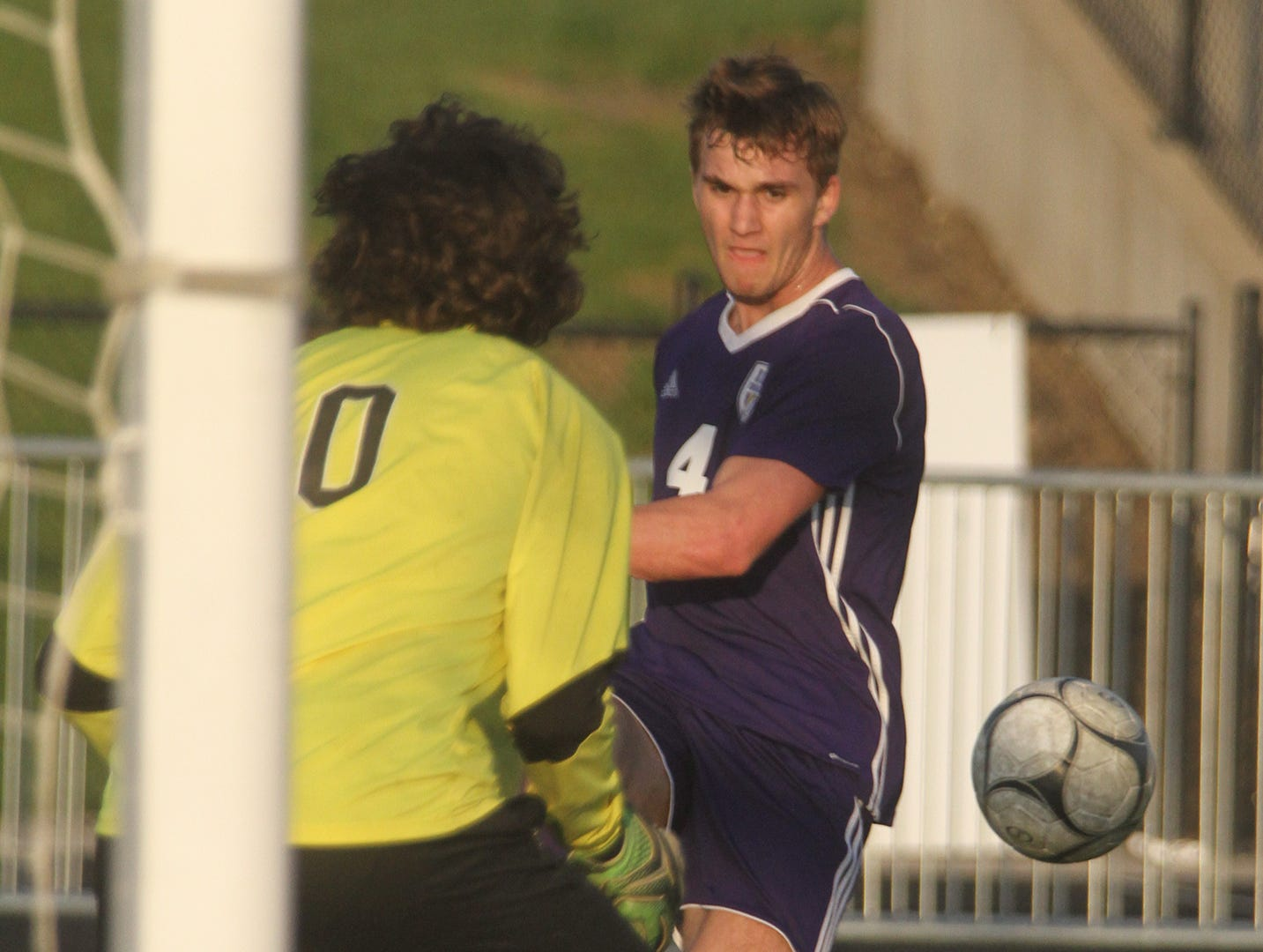 Indianola junior Carter Bussanmas fires a shot at Newton sophomore goalkeeper Josh Meyer. Indianola beat Newton 2-0 at home in a Little Hawkeye Conference game.