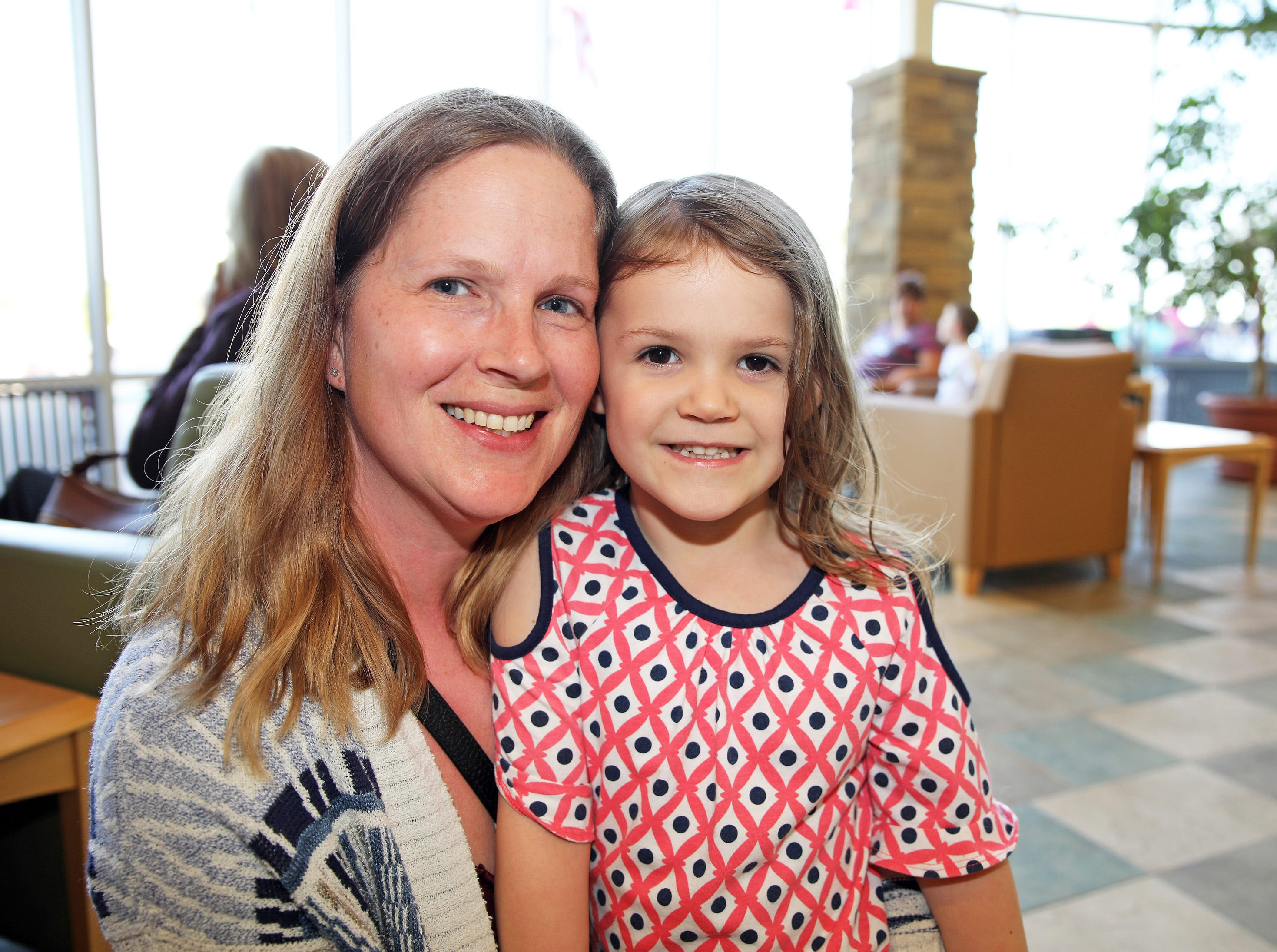 Wendy and Allyson Tuffin, 4, of Ankeny wait to take a tour of the police station during the Ankeny Police Week Community Picnic on Tuesday, May 14, 2019 at the Ankeny Police Headquarters located at 411 SW Ordnance Road. The event featured a tour of the police station, magician Jonathon May, free Chick Fil-A sandwiches for the first 1,000 guests, free Kona Ice, temporary tattoos, and a great opportunity to meet the officers who protect and serve the city of Ankeny.