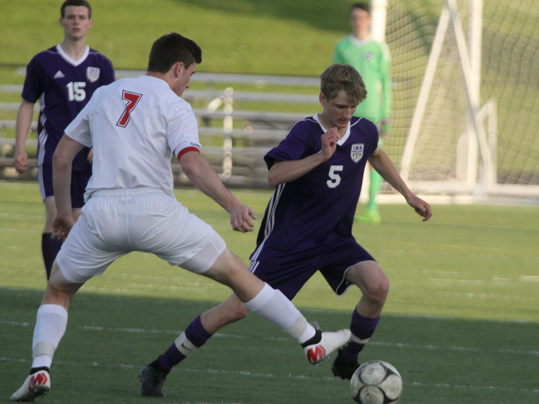 Indianola junior Chandler Lowry goes around Newton senior Jacob Murphy. Indianola beat Newton 2-0 at home in a Little Hawkeye Conference game.