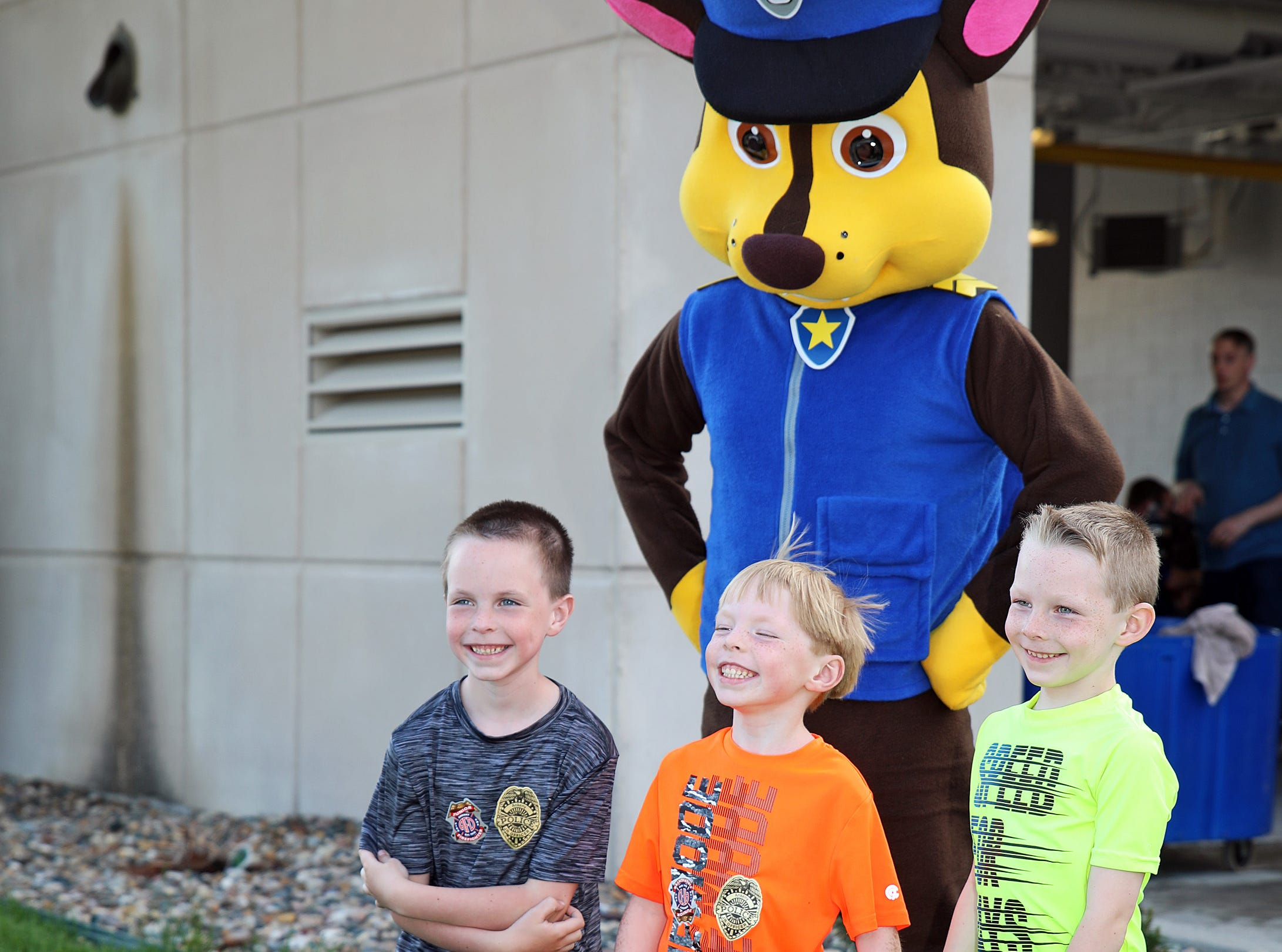 The PAW Patrol is on the scene and Chase is on the case with three young men during the Ankeny Police Week Community Picnic on Tuesday, May 14, 2019 at the Ankeny Police Headquarters located at 411 SW Ordnance Road. The event featured a tour of the police station, magician Jonathon May, free Chick Fil-A sandwiches for the first 1,000 guests, free Kona Ice, temporary tattoos, and a great opportunity to meet the officers who protect and serve the city of Ankeny.