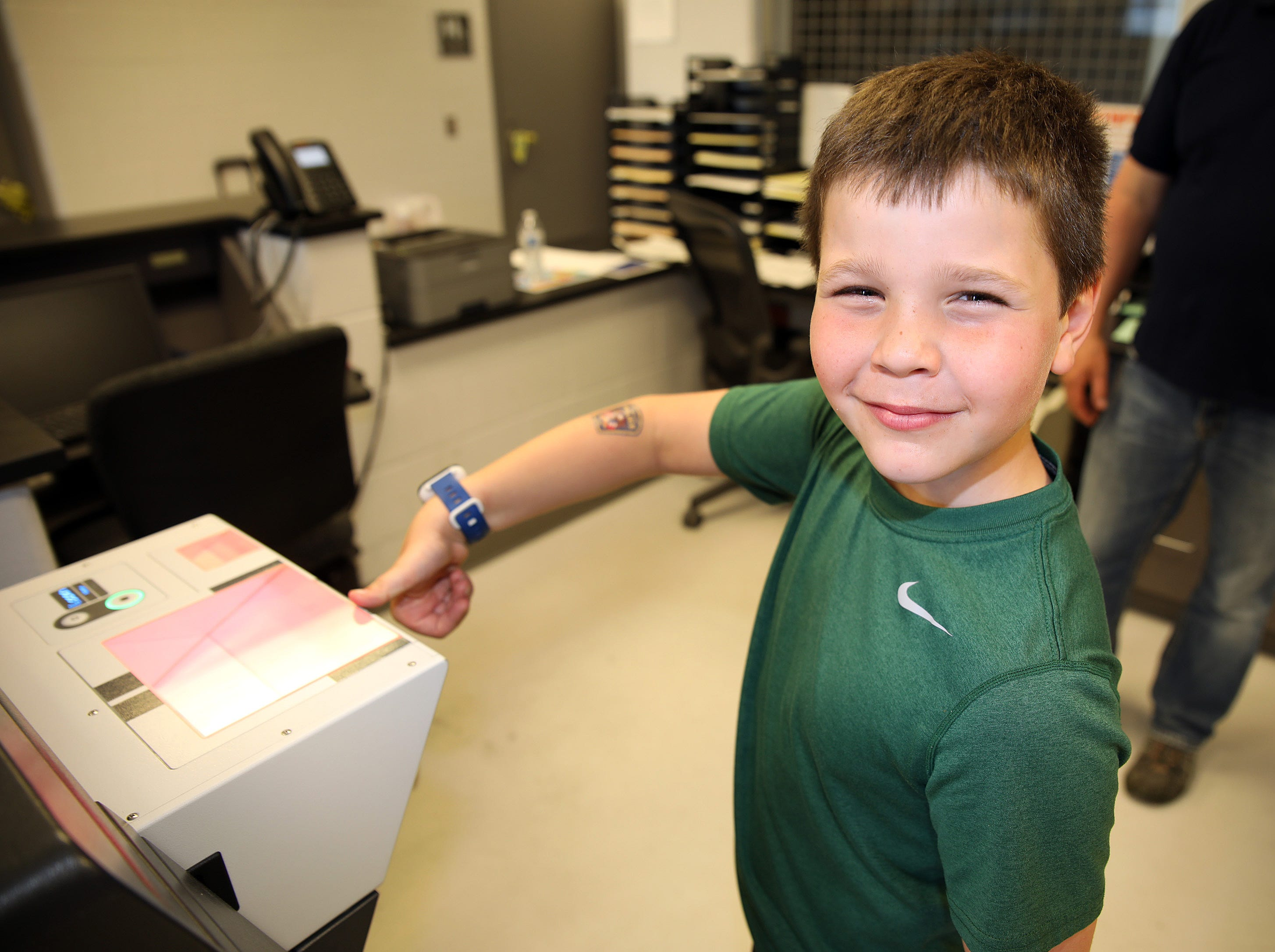 Liam Kroska, 8, of Ankeny is ready for a fingerprint test during the Ankeny Police Week Community Picnic on Tuesday, May 14, 2019 at the Ankeny Police Headquarters located at 411 SW Ordnance Road. The event featured a tour of the police station, magician Jonathon May, free Chick Fil-A sandwiches for the first 1,000 guests, free Kona Ice, temporary tattoos, and a great opportunity to meet the officers who protect and serve the city of Ankeny.