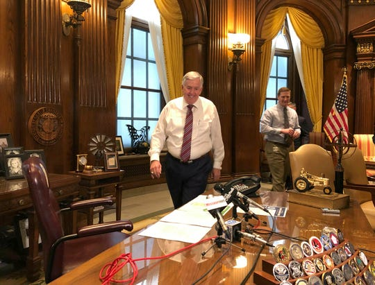 Missouri Gov. Mike Parson arrives for a news conference Tuesday, May 14, 2019, in his Capitol office in Jefferson City, Missouri. Parson said he wants an up-or-down vote in the Senate on legislation that authorizes up to $50 million of tax credits for General Motors, gives state officials the option of granting upfront incentives to other businesses and creates a new college scholarship for adults. Some Republican senators have blocked the chamber's work in opposition to the bill.