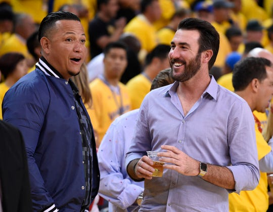 Miguel Cabrera, left, and Justin Verlander laugh during an NBA playoff game at Oracle Arena, May 27, 2015 in Oakland.