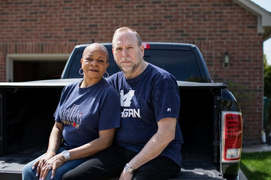 Mary Kimbel, 71, and her husband, Gary Kimbel, 66, are photographed on the tailgate of their 2017 Dodge Ram in Macomb Twp., Mich., Wednesday, May 15, 2019. The couple got a $2,000 annual increase in their auto insurance premiums when Gary turned 65, because Medicare will only serve as secondary coverage for medical expenses related to an auto accident.