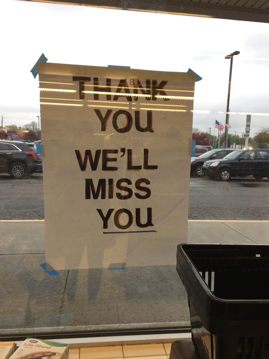 A makeshift sign in the window at Kroger No. 453 in Dearborn on May 11, 2019.