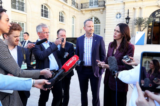 New Zealand Prime Minister Jacinda Ardern, right, gives a press conference, at the OECD headquarters, in Paris, Tuesday, May 14, 2019.