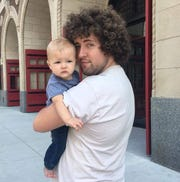 Ely Hydes with his son, Cy.
