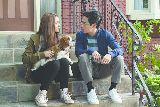 "Kathryn Prescott and Henry Lau in ""A Dog's Journey."""
