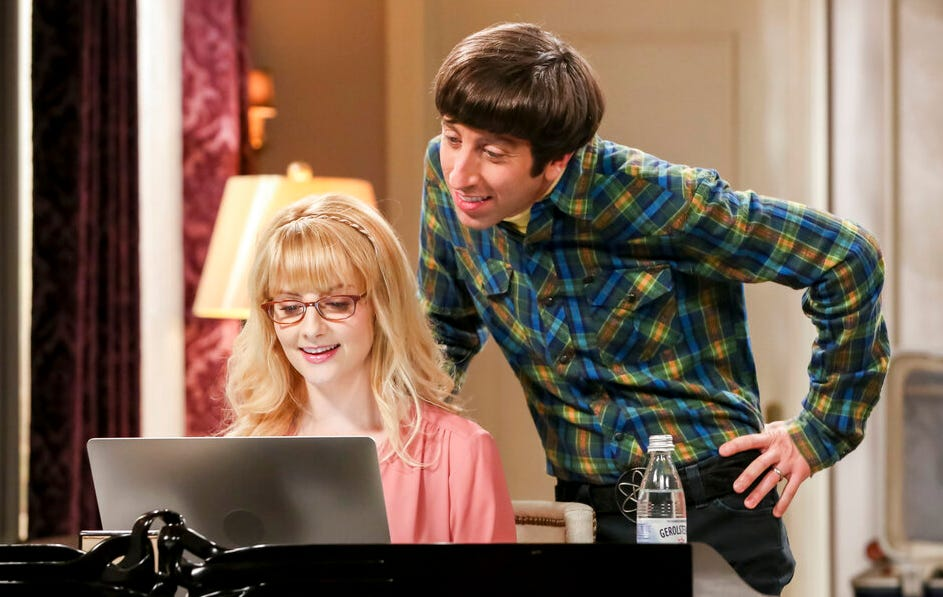 """This image released by CBS shows Melissa Rauch, left, and Simon Helberg in a scene from the series finale of """"The Big Bang Theory."""""""