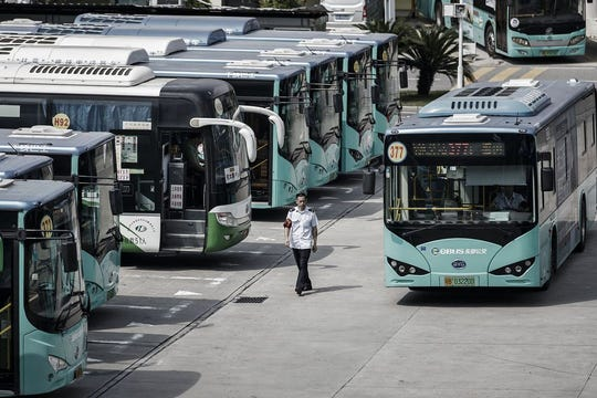 An electric bus made by BYD arrives at a public transportation hub in Shenzhen, China.