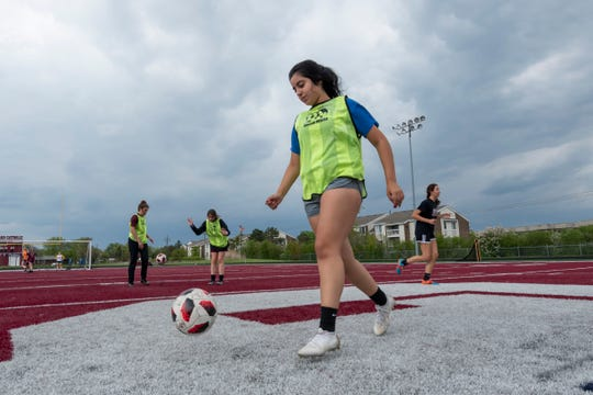 Patty Aguilar goes through drills with her teammates during soccer practice at Gabriel Richard Catholic High School in Riverview, Wednesday.