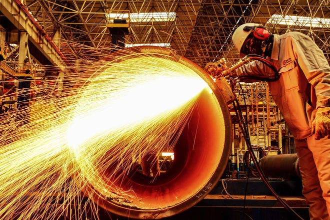 A worker cuts an oil pipe at a factory in Qingdao in China's eastern Shandong province on February 28, 2019. - China's manufacturing activity shrunk for a third straight month in February, sinking to its worst performance in three years as the economy slows and the US trade war bites, official data showed on February 28. (Photo by STR / AFP) / China OUTSTR/AFP/Getty Images