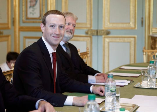 Facebook CEO Mark Zuckerberg smiles as he meets French President Emmanuel Macron meet at at the Elysee Palace, in Paris, France, Friday, May 10, 2019.