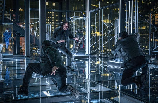 "Keanu Reeves (center) in ""John Wick 3: Parabellum."""