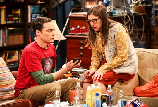 """This image released by CBS shows Jim Parsons, left, and Mayim Bialik in a scene from the series finale of """"The Big Bang Theory,"""" airing on Thursday."""
