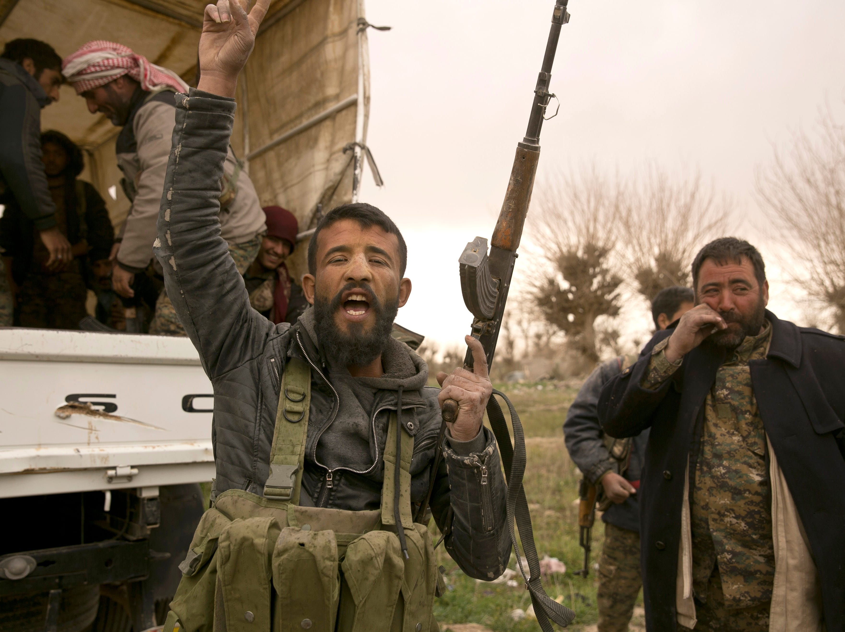 A U.S.-backed Syrian Democratic Forces (SDF) fighter chants slogans before heading to the front line to fight Islamic State militants in their last stronghold of Baghouz, Syria, Thursday, March 14, 2019.