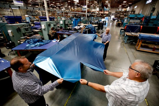 In this July 5, 2018, file photo workers assemble the Afloat water mattresses at the factory in Corona, Calif.