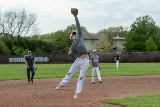 Haydon Burke, a senior at Gabriel Richard Catholic High School, leaps to make a catch during baseball practice in Riverview, Wednesday.