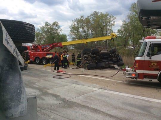 A gravel hauler has overturned on I-75.