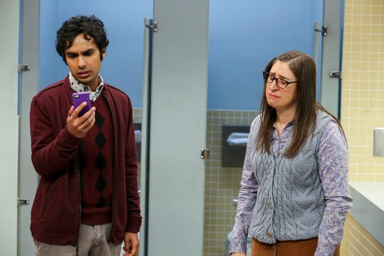 """Kunal Nayyar, left, and Mayim Bialik in a scene from the series finale of """"The Big Bang Theory."""""""
