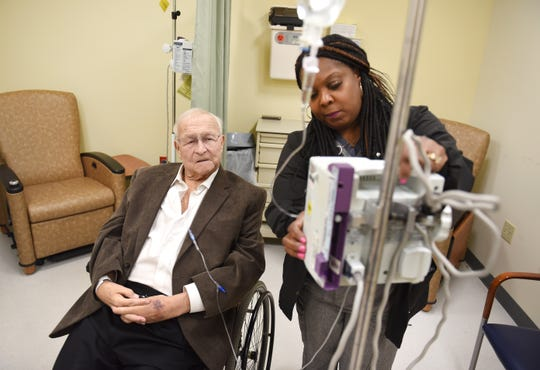 Oakland County Executive L. Brooks Patterson is given an IV by nurse Denise Turner for his cancer treatment at Karmanos Cancer Institute in Farmington Hills.