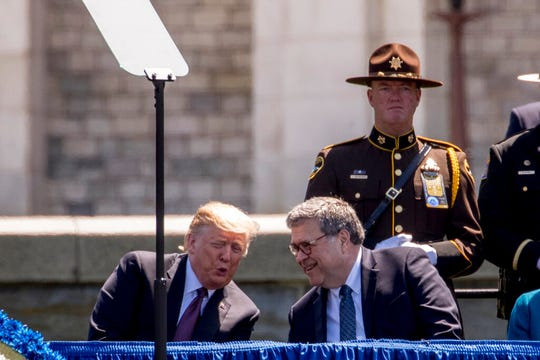 President Donald Trump speaks with Attorney General William Barr, right, at the 38th Annual National Peace Officers Memorial Service on the West Lawn of the Capitol Building, Wednesday, May 15, 2019, in Washington.