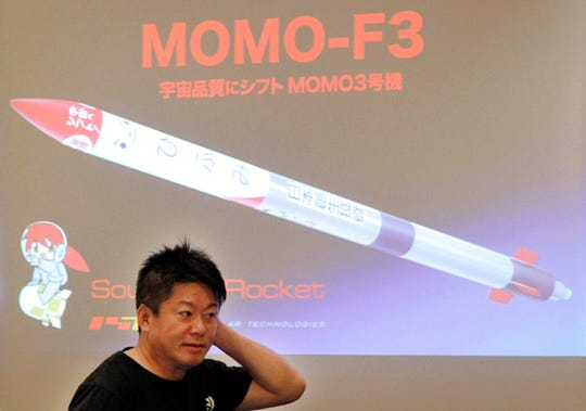 Japanese entrepreneurs and Founder of Interstellar Technologies Inc. Takafumi Horie speaks during a press conference in Tokyo, Wednesday, May 15, 2019. Horie said a low-cost rocket business in Japan is well-positioned to accommodate scientific and commercial needs in Asia.