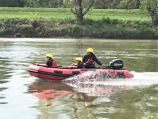 Members of the Elmira Fire Department demonstrate a new rescue boat Wednesday near the Chemung River Grove Street boat launch in Elmira.