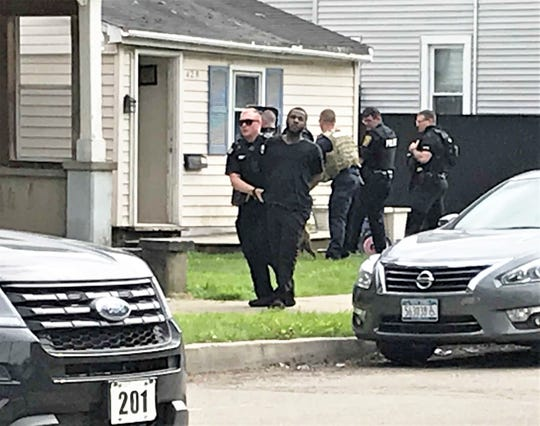 Elmira police take a man into custody following a standoff Wednesday near the corner of Standish and Oak streets in the city.
