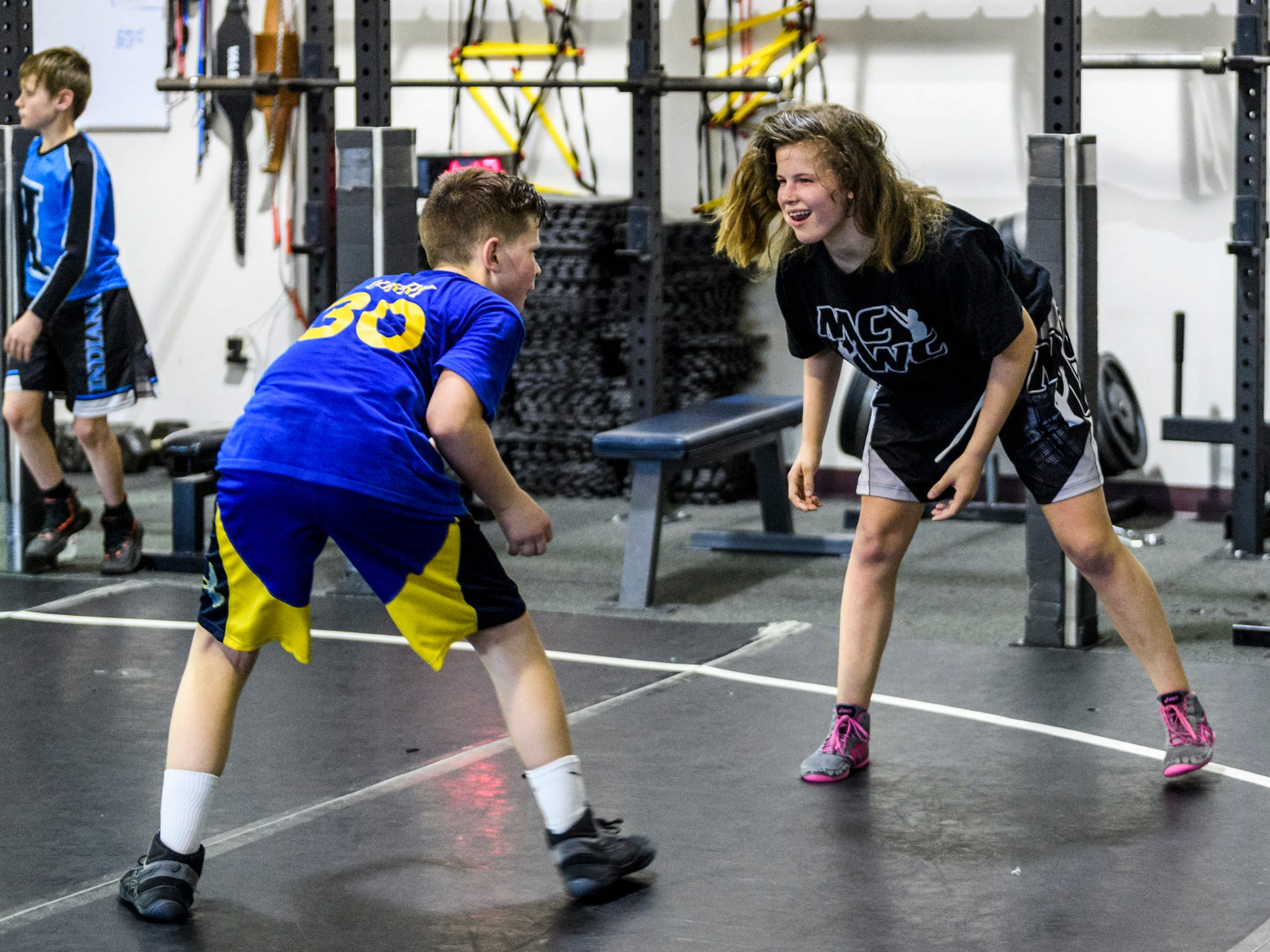 Kaylie Petersen, right, prepares to wrestle her frequent practice partner 12-year-old Maddux Ranson, right, at Maurer Coughlin Wrestling Club in Evansville on a recent Tuesday evening. She's been attending practices and receiving coaching at MCWC since 2014 and is often the only girl on the wrestling mat.