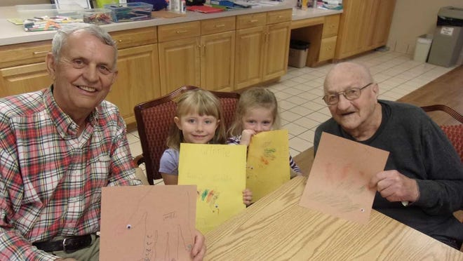 Treffert Academy students show off their drawings with Adult Day Services clients. From left, Tom Kescenovitz, Winnie Olig, Kamryn LaBrec and Joe Stocker.