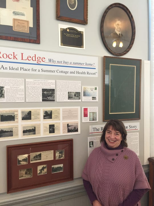 Alison Lanza Falls and the Museum display panel about founding Catawba's Rock Ledge neighborhood.
