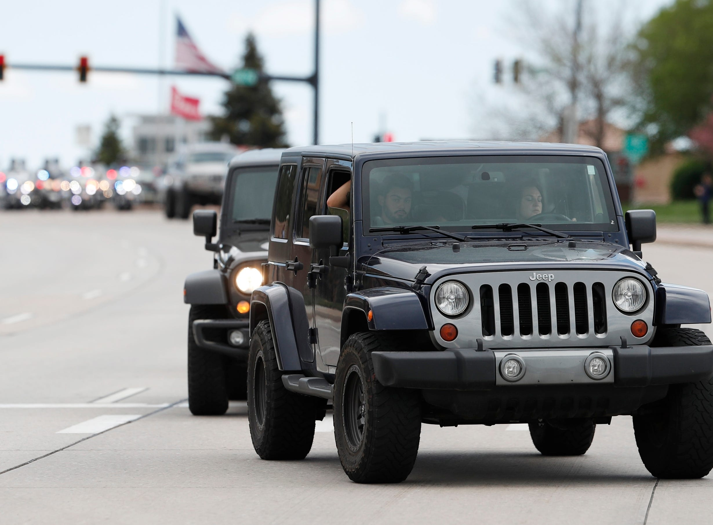 More than 600 Jeeps lead a caravan to the memorial service for Kendrick Castillo, who was killed in the assault on the STEM Highlands Ranch School, Wednesday, May 15, 2019, in Highlands Ranch, Colo.