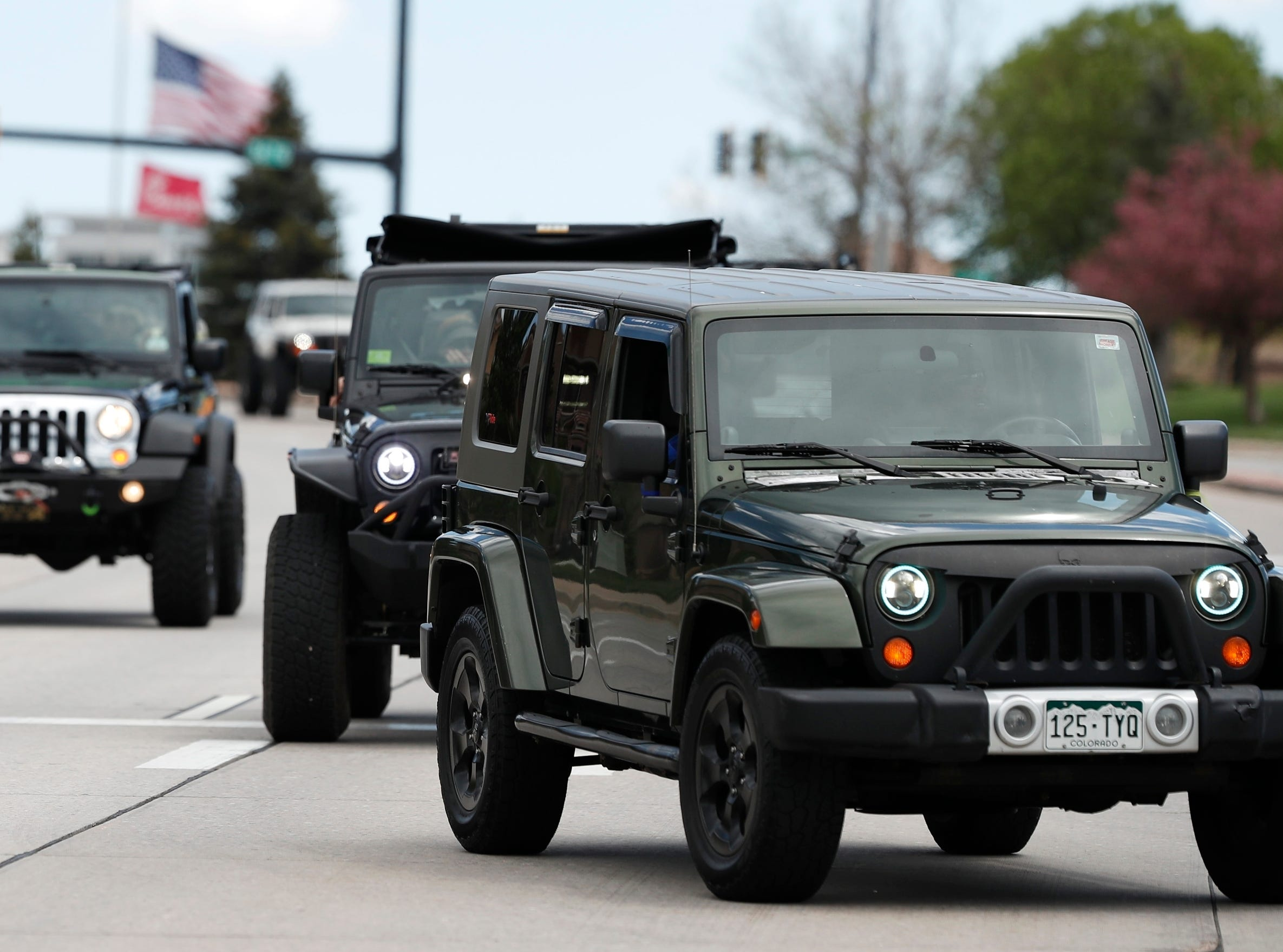 More than 600 Jeeps arrive for a memorial service for Kendrick Castillo Wednesday, May 15, 2019, in Highlands Ranch, Colo. Castillo loved his Jeep and off-roading so other Jeep enthusiasts answered the call to help show their appreciation for his heroism. Castillo was killed while trying to stop an alleged gunman at his Colorado school.