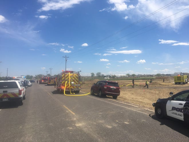 First responders work at the scene of an airplane crash Wednesday afternoon near the Northern Colorado Regional Airport in Loveland.
