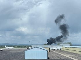 Dark smoke from a plane crash near the Northern Colorado Regional Airport can be seen from Leading Edge Flight Training at the airport.