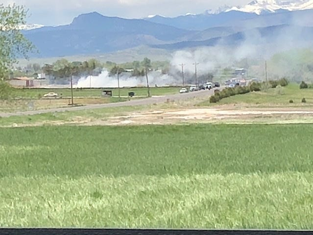 Smoke is visible at the site of a plane crash near County Road 30 and the Larimer Humane Society in Loveland.