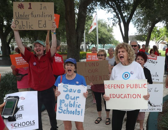 Concerned citizens and Collier County educators protest in front of the Collier County Courthouse on Wednesday, May 15, 2019. They were protesting several topics including low wages and gun violence in schools.