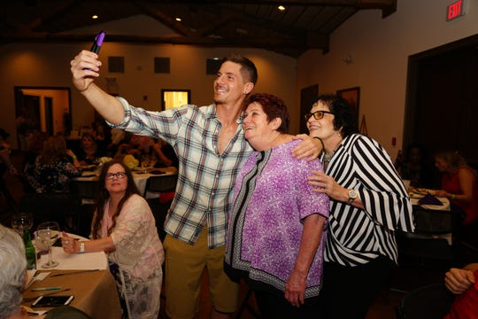 "Soap actor Robert Adamson poses for selfies with guests at the 2018 SoapFest's ""Night of the Stars"" event."