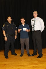 The Cape Coral Police Department   honored teacher  Nevin Marshall for saving a choking teacher at Trafalgar Middle School this month.