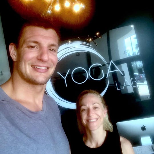 Former New England Patriots tight end Rob Gronkowski recently took a class at Yoga Lab in Estero.
