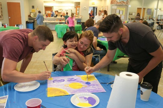 Soap stars Robert Adamson and Josh Swickard make a mini masterpiece to raise funds for children with autism at the 2018 SoapFest.