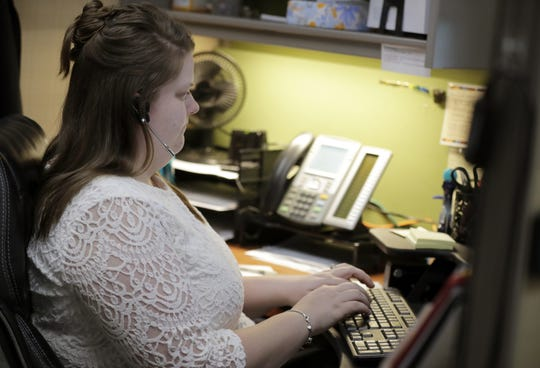 Client Access Specialist Isabella Hielsberg at work in the call center at Catalpa Health in Grand Chute.