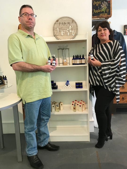 Mike Swille and Stacey Deprey-Purper with some of the products in their new One Health Wisconsin shop in Algoma, which sells CBD oils and other natural health products.