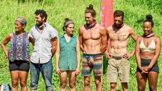 """Greenville resident Chris Underwood, second from left, with his fellow Extinction Island exiles, on the season finale of """"Survivor: Edge of Extinction."""""""