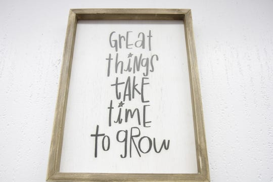This motivational wall art can be found in the lobby area of the learning center.