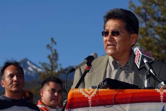 FILE - In this March 12, 2007 file photo, Ben Nuvamsa, chairman of the Hopi Tribe, speaks at a news conference in Buffalo Park in Flagstaff, Ariz. Native American groups are pressing for permanent protections for grizzly bears, a species some tribes consider sacred but that has been proposed for hunting in Wyoming and Idaho. Tribal representatives were scheduled to appear Wednesday, May 15, 2019, before Congress in support of legislation to block grizzly hunting in the Lower 48 states, regardless of the species' population size. Nuvamsa says grizzlies play a central role in the traditions and ceremonies of many tribes. (Jake Bacon/Arizona Daily Sun via AP, File)