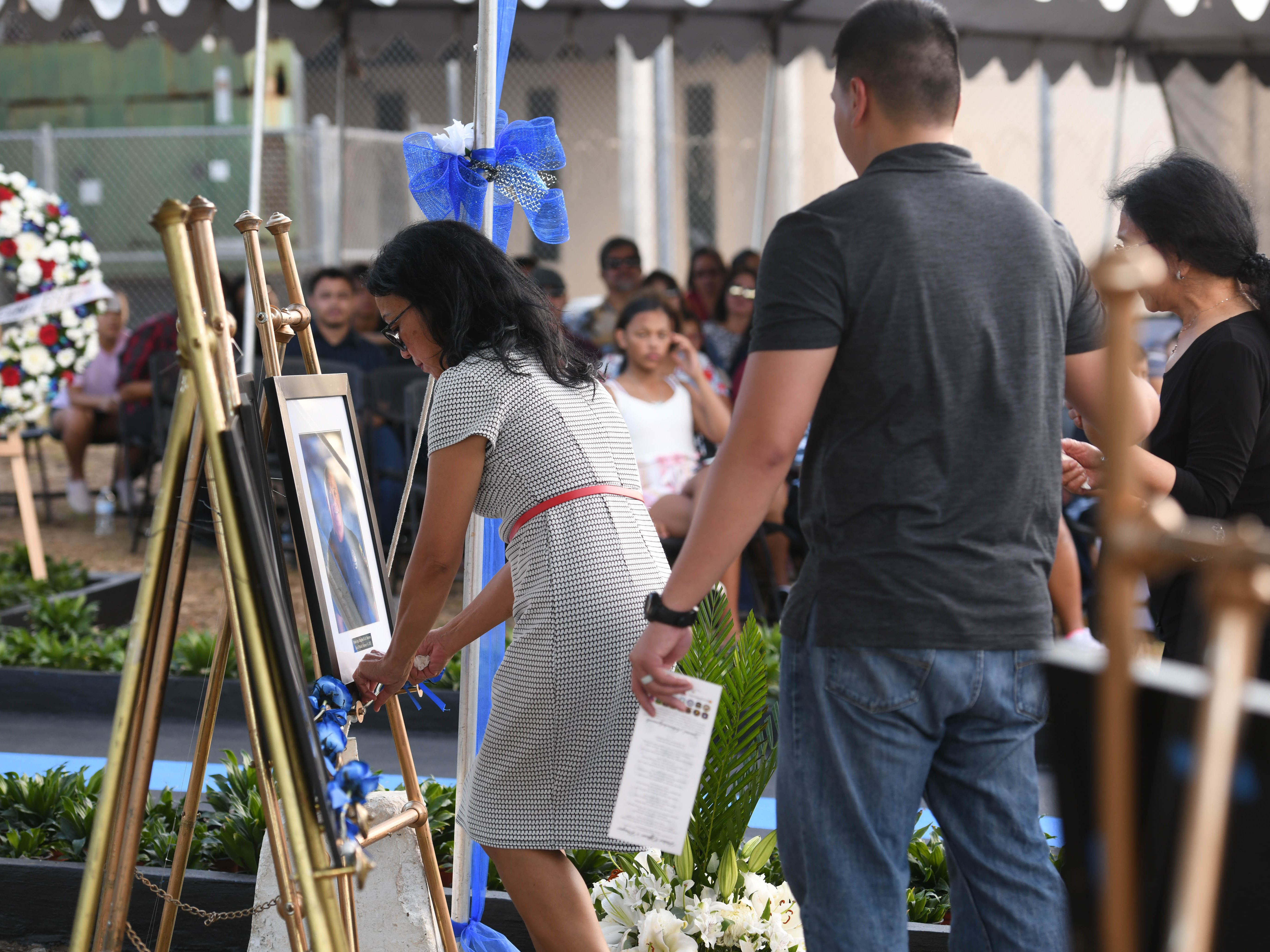 The service of Police Sgt. Siegfred Mortera is remembered during the Peace Officers' Memorial service and wreath laying ceremony held at the Guam Police Department's Badge memorial Park in Hagåtña on Wednesday, May 15, 2019.