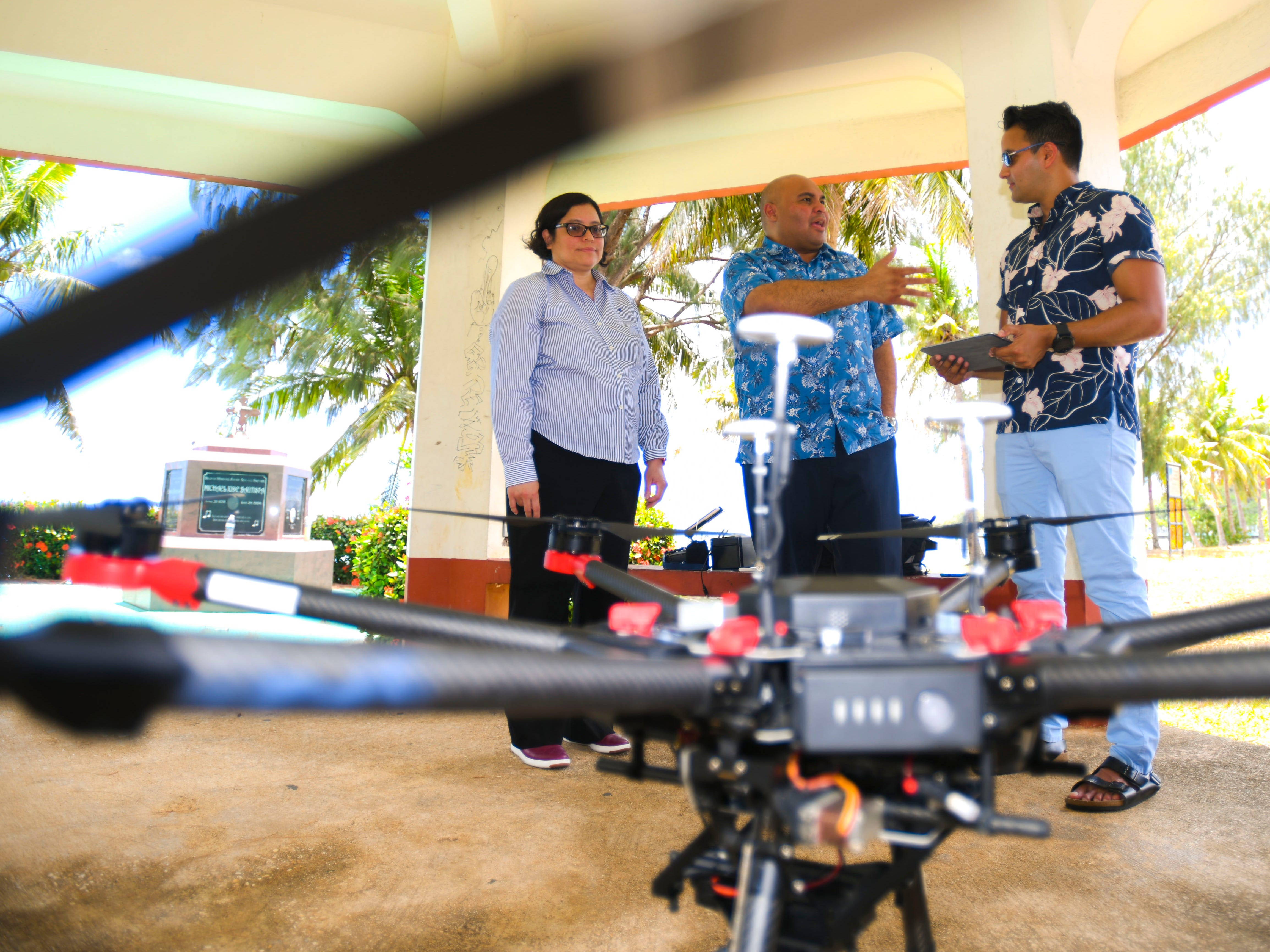 Researchers from the University of Guam's Pacific Islands Climate Adaptation Science Center and NASA's Lab for Advance Sensing Earth Science Division prepare to demonstrate the flight of an unmanned NASA aerial vehicle at Tepungan Beach Park, near Fisheye Marine Park in Piti, on Wednesday, May 15, 2019. The drone, using Fluid Lensing technology developed by research scientist Ved Chirayath, has been able to map the underwater coral formations in the waters of Piti and Tumon from the air.